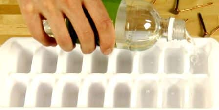 Pouring Vinegar in Ice Cube Tray